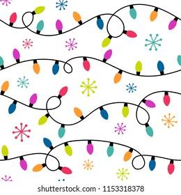Seamless pattern of colorful christmas light bulbs and snowflakes.