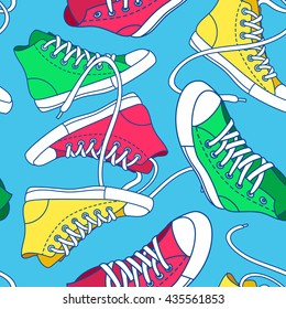 Seamless pattern with colorful shoes. Hand drawn gumshoes