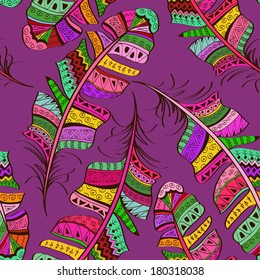 Seamless pattern of colorful tribal ornate bird feathers on purple background