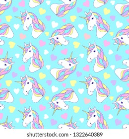Seamless pattern with colorful unicorns and hearts on blue background.Surface pattern.It be perfect for fabric,stationery, clothing, accessories, digital paper and more.