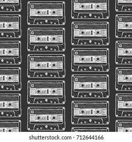 Seamless pattern with Compact Cassette in vintage engraved style on black background.