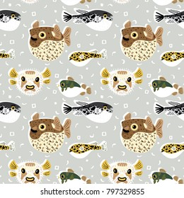 Seamless pattern with cute cartoon blowfishes