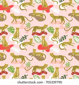 Seamless pattern with cute cartoon leopards and tropical leaves