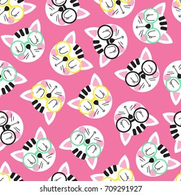 Seamless pattern with cute cat head in glasses on a pink background. Seamless background for children. Vector illustration.
