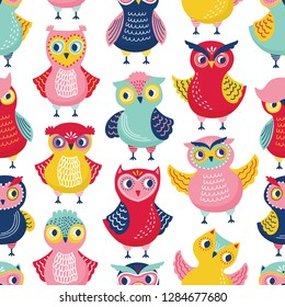 Seamless pattern with cute funny owls or owlets on white background. Childish backdrop with intelligent forest birds. Flat cartoon vector illustration for wrapping paper, wallpaper, textile print.