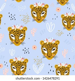 Seamless pattern with cute hand drawn leopard faces. Creative childish jungle background .Vector Illustration