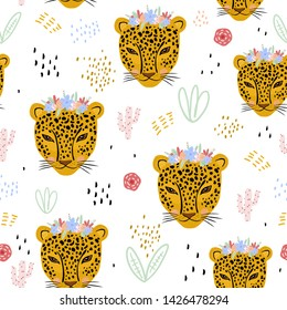 Seamless pattern with cute hand drawn leopard faces. Creative childish jungle background. Vector Illustration