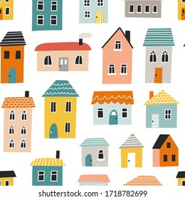 Seamless pattern with cute houses. Hand drawn vector illustration for nursery textile or wallpaper design.
