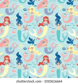 Seamless pattern with cute mermaids