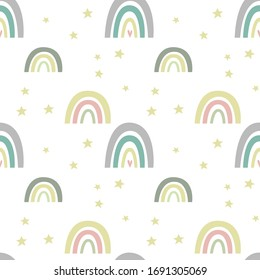 Seamless pattern with cute nursery rainbow, stars, scandinavian fun print. Pastel colours. Creative kids texture for poster, fabric, wrapping, textile, wallpaper, apparel. Vector flat illustration