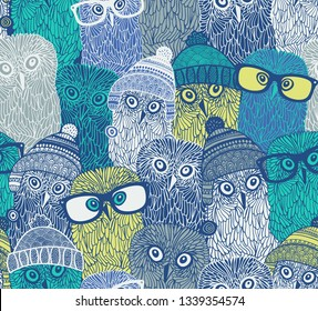 Seamless pattern with cute owls in hats and glasses. Vector wallpaper of arctic birds in scandinavian style.