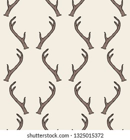 Seamless pattern with deer antlers. Vector hipster trendy background. Nature wildlife animal light brown backdrop.