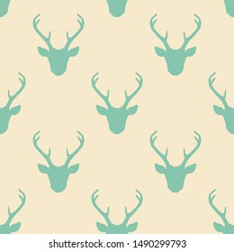 Seamless pattern with deer heads silhouettes. Vector hipster trendy background. Nature wildlife animal pastel backdrop in teal over beige.