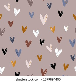 Seamless pattern design with colorful hearts in boho style. Vector romantic background. Great for fabric, textile, apparel.