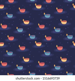 Seamless pattern for Diwali Hindu festival with cute diya lamps. Childish print for wrapping paper, background and wallpaper. Vector illustration