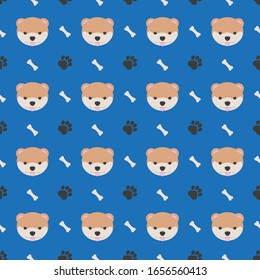 seamless pattern with dog face, footprint and bone on a blue background