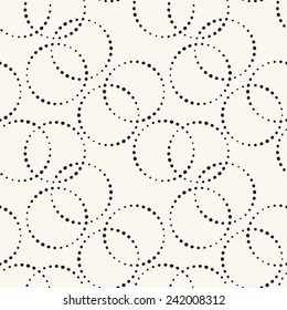 Seamless pattern with dotted circles. Vector repeating texture. Stylish background