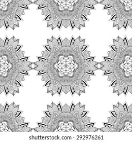 Seamless pattern in ethnic style. Black and white geometric symmetry hand drawn ornament. Boho, oriental, vintage style. Vector pattern