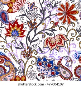 Seamless pattern in ethnic traditional style. The pattern of mandalas and Paisley pattern in Indian style.