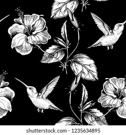 Seamless pattern. Exotic Hibiscus flowers and hummingbird. Textile composition, hand drawn style print. Vector black and white illustration.