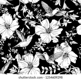 Seamless pattern. Exotic Hibiscus flowers, different herbs and hummingbird. Textile composition, hand drawn style print. Vector black and white illustration.