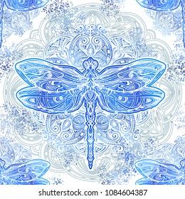 Seamless pattern - exquisite ornate stylized dragonfly against the background of the mandala. Spiritual, esoteric, totem symbol. Ethnic tribal patterns with elements of Ar Nouveau and Boho.