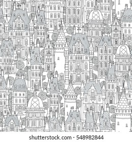 Seamless pattern of fantasy urban landscape. Fairy tale castle, old medieval town.Hand drawn sketch, house,tower silhouette.T-shirt print.Coloring book page for adults, children.Black and white doodle