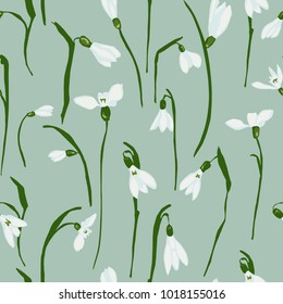 Seamless pattern with the first spring flowers with snowdrops. Vector illustration with graphic snowdrops