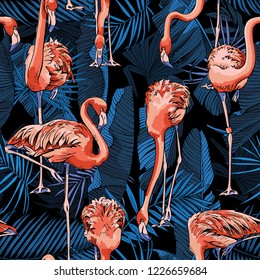 Seamless pattern. Flamingo and a Tropical banana, exotic palm leaves at a dark blue night. Textile composition, hand drawn style print. Vector illustration.