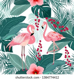 Seamless pattern of flamingo, tropical leaves of palm tree. Vector background.