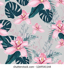 Seamless pattern with flowers Orchid,  colorful tropical leaves and herbs. Exotic illustration in vintage style on light grey background.