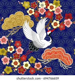 Seamless pattern with flying birds. Crane. Heron. Japanese pattern. Ornament with oriental motifs. Vector.