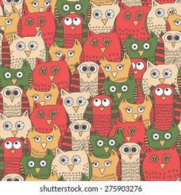 Seamless pattern with funny bright owls in cartoon style. Vector illustration