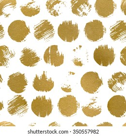 Seamless pattern with gold painted dots. Abstract geometric modern background. Vector illustration. Shiny backdrop. Texture of gold foil.