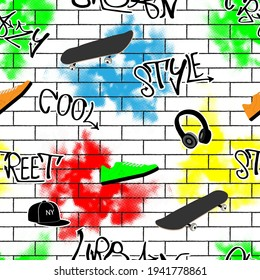 Seamless pattern Graffiti Urban stil.skeyt, text, cap, headphones and sneakers on the bricks
