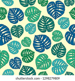Seamless pattern with green,blue and aquamarine palm leaves on a beige background.Tropical print for fabric,wrapping paper,wallpaper,planners,mugs,background for your design