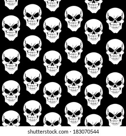 Seamless pattern from grinning skulls on black background