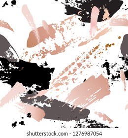 Seamless pattern - grunge brush strokes in pastel gold rose pink, grey and black on white background. Creative modern background: glossy splashes, copper smudge paint texture. Vector illustration