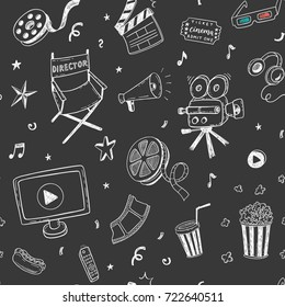 Seamless pattern with hand drawn cinema doodles on a chalkboard background