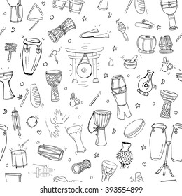 Seamless pattern with hand drawn doodles of traditional percussion instruments scattered on white background.