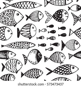 Seamless pattern with hand drawn funny fishes in sketch style. Vector decorative endless marine background. Fabric design.