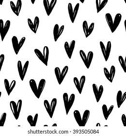 Seamless pattern with hand drawn graphic hearts. Ink illustration. Hand drawn ornament for wrapping paper. Decorative pattern for banners, flayers, cards and posters, for invitation on weddings.