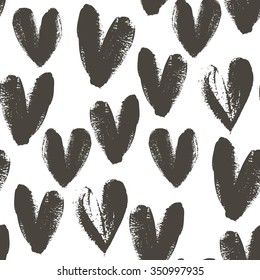 Seamless pattern with hand drawn heart. Hearts painted dry brush. Ink illustration. Ornament for wrapping paper. Isolated on white background. Artistic texture.