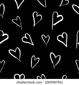 Seamless pattern with hand drawn hearts on black background. Vector illustration
