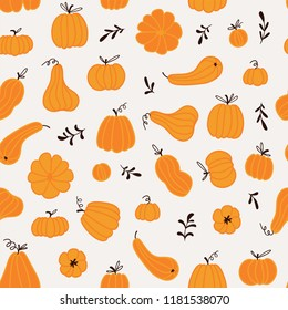 Seamless pattern with hand drawn pumpkins and leaves. Cute design  for Halloween or Thankful day. Vector vegetable illustration.
