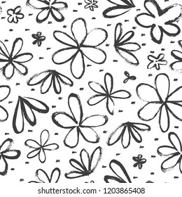 Seamless pattern with hand-drawn abstract flowers on a white background. Cute hand drawn vector illustration.