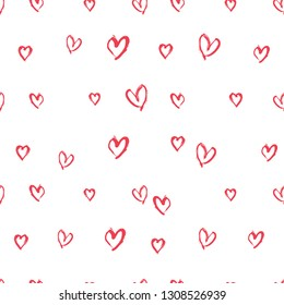 Seamless pattern of handwritten red hearts. Imitation of drawing with a stiff brush template of hearts for Valentine's Day. Vector template for romantic design.