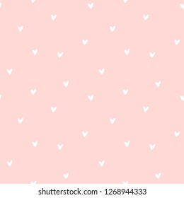 Seamless pattern with hearts on pink background. Vector illustration.