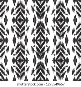 Seamless pattern for home decor ideas. Ikat chevron wallpaper. Ethnic, indian, aztec fashion style. Pillow textile decoration. Tribal background. Black and white graphic design.