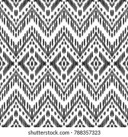 Seamless pattern for home decor ideas. Ikat chevron wallpaper. Ethnic, indian, aztec fashion style. Pillow textile decoration. Tribal vector background. Black and white graphic design.